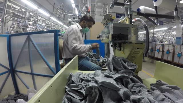 production process at nike and adidas supplier interloop ltd, faisalabad, punjab, pakistan, on tuesday, nov 6, 2018. - adidas stock videos & royalty-free footage