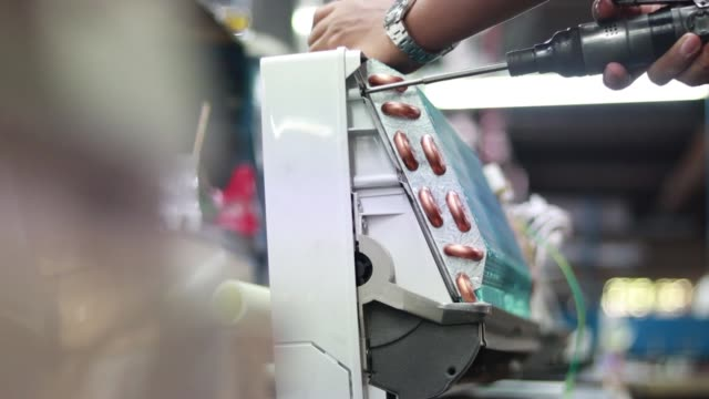 production staff are fastening screws to assemble the cold coil with the air conditioner in the production line in the industrial factory. - air conditioner stock videos & royalty-free footage