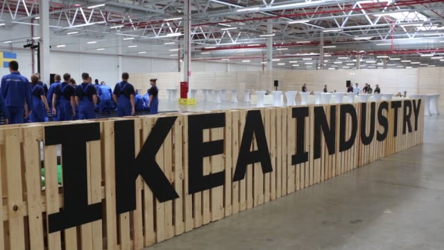 production statistics sit on the wall inside the new ikea ab manufacturing plant in velikiy novgorod, russia on wednesday, sept 7 an ikea sign stands... - employment issues stock videos & royalty-free footage