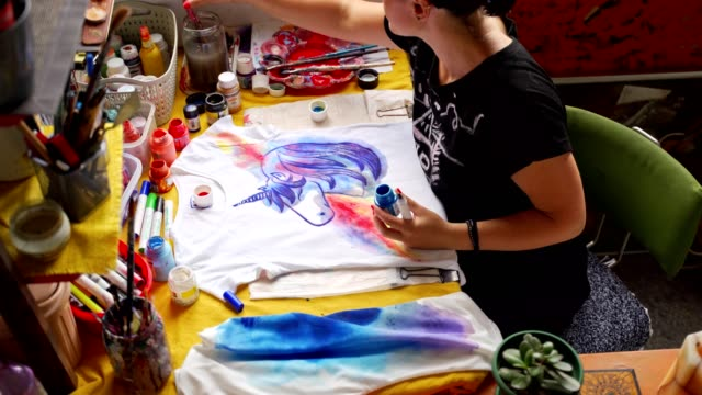 productive female artist working in her messy workshop - imperfection stock videos & royalty-free footage
