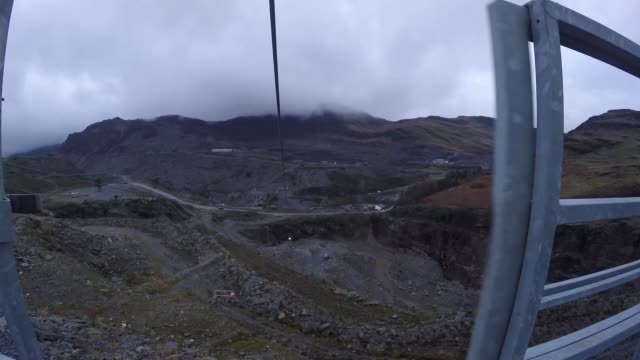 UK productivity remains low ahead of Budget statement WALES Gwynedd Bethesda Penrhyn Quarry PRO footage as along zip wire Wide shot reporter along on...