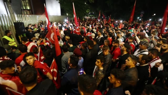 pro-erdogan berlin turks wave turkish flags during a gathering in front of the turkish embassy to commemorate the first anniversary of the failed... - coup d'état stock videos & royalty-free footage