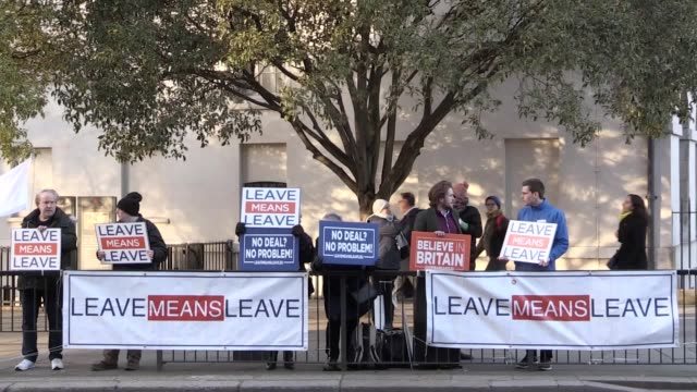proeu and brexit campaign groups gather outside westminster with police vans parked outside college green with pairs of police officers stationed at... - stationary stock videos & royalty-free footage