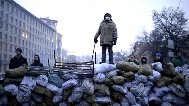 ProEuropean demonstrators and police forces stand facetoface in the centre of Kiev sealed off by barricades since the authorities scrapped a key deal...