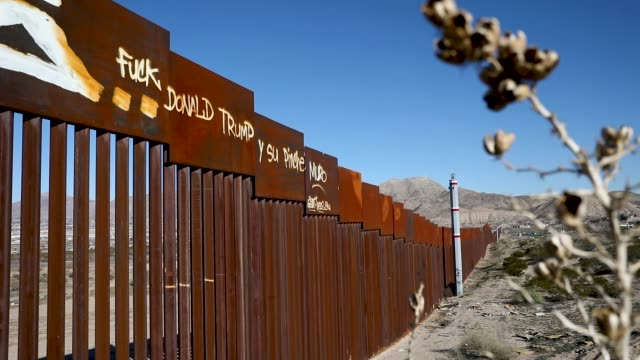 image contains profanity) a profane message written to the u.s. president donald trump is seen written on a part of the u.s. border wall on january... - government shutdown stock videos & royalty-free footage