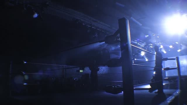 Professional American style wrestling ring doused with eerie blue light before a match