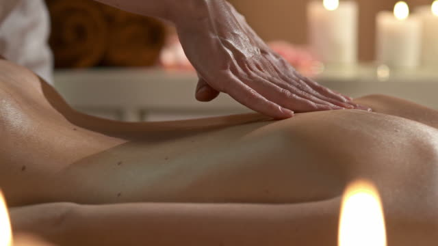 hd dolly: professional back massage - massage table stock videos & royalty-free footage