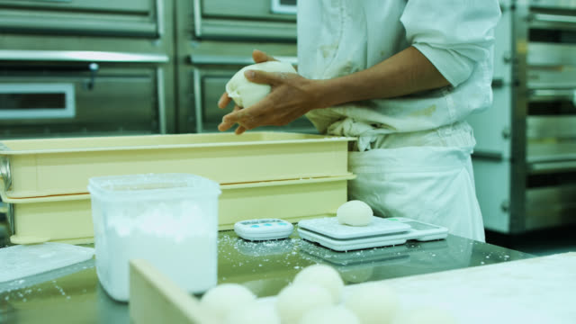 professional baker tearing lumps from mochi dough - rice ball stock videos & royalty-free footage
