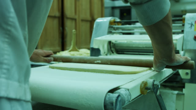 professional baker using rolling pin - rolling pin stock videos & royalty-free footage