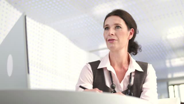 HD: Professional Bank Teller At Work