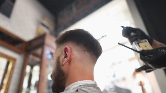 professional barber at his barber shop - mirror stock videos & royalty-free footage