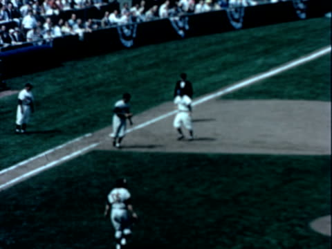 professional baseball game in progress the teams are unidentified / crowd milling about outside of stadium baseball game on january 01 1960 - 1960 stock videos & royalty-free footage