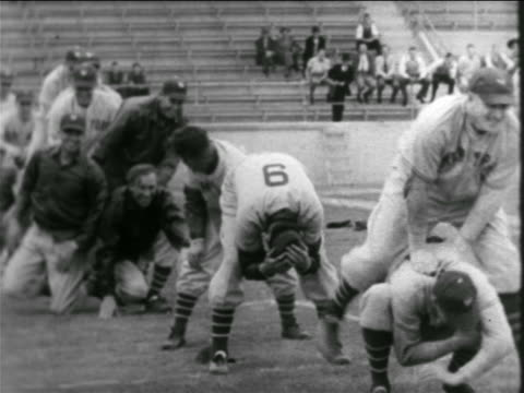 b/w 1938 professional baseball players leap frogging over other players bent over - leapfrog stock videos & royalty-free footage