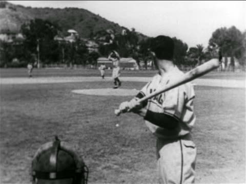 vídeos de stock e filmes b-roll de b/w 1938 professional baseball players pitching batting in practice game / catalina island ca - camisola de basebol