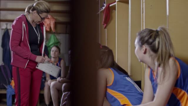 Professional basketball coach talking to female team in locker room