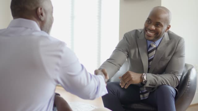 professional business advisor handshake with customer during a home meeting - customer stock videos & royalty-free footage