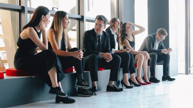 professional business people waiting in line for interview in office - laptops in a row stock videos & royalty-free footage