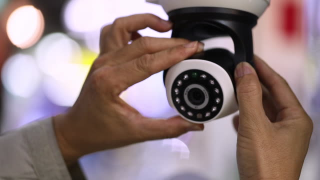 professional cctv technician working. - installing stock videos & royalty-free footage