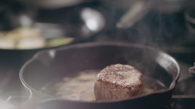 slo mo. professional chef checks to see if steak is done by pushing the sides - filleted stock videos & royalty-free footage