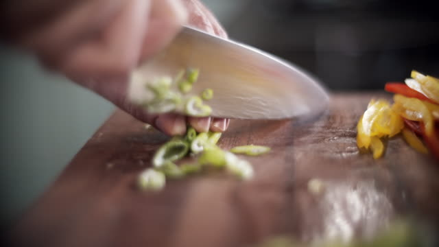 professional chef slicing an onion in professional kitchen - foodie stock videos and b-roll footage