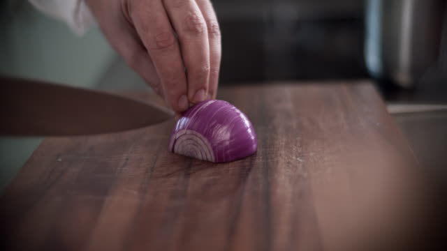 professional chef slicing an onion - skill stock videos & royalty-free footage