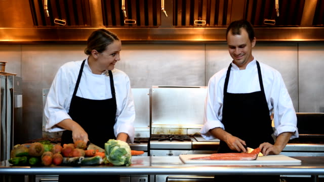 professional chefs at work - caterer stock videos and b-roll footage