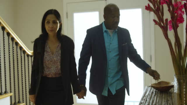 professional couple arriving home - arrival stock videos & royalty-free footage
