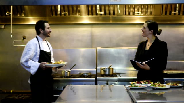 professional culinary team in a commercial kitchen - domestic staff stock videos and b-roll footage