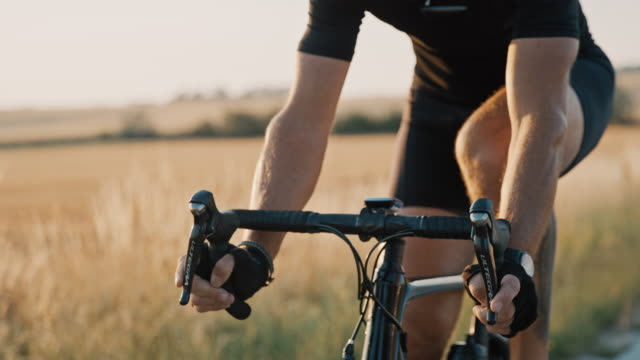 slo mo professional cyclist riding a bike through the countryside - instrument of measurement stock videos & royalty-free footage