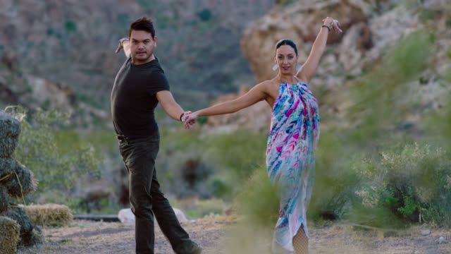slo mo. professional dancers twirl and strike elegant pose in scenic nevada desert. - fishnet stock videos and b-roll footage
