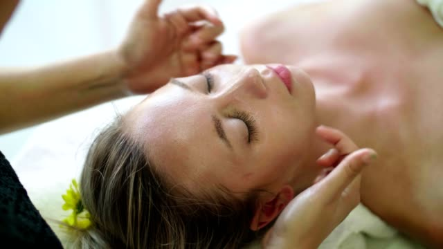 professional facial massage in spa center - facial massage stock videos and b-roll footage