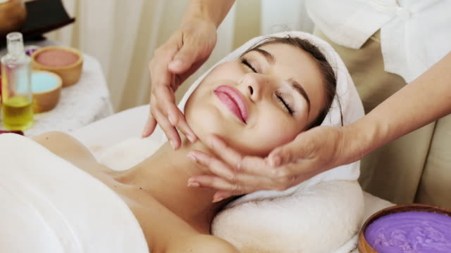 professional facial massage. - head massage stock videos and b-roll footage