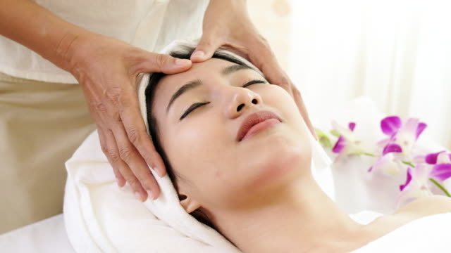 professional facial massage. - facial massage stock videos and b-roll footage