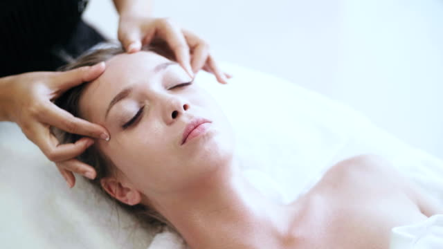 professional facial massage - head massage stock videos and b-roll footage
