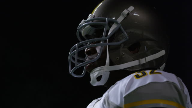 CU LA Professional football player on field during night game wearing helmet