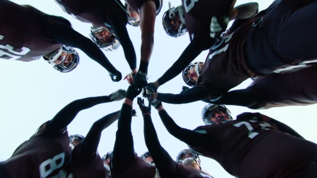 ms la pov professional football team coming together before start of game - teamwork stock-videos und b-roll-filmmaterial