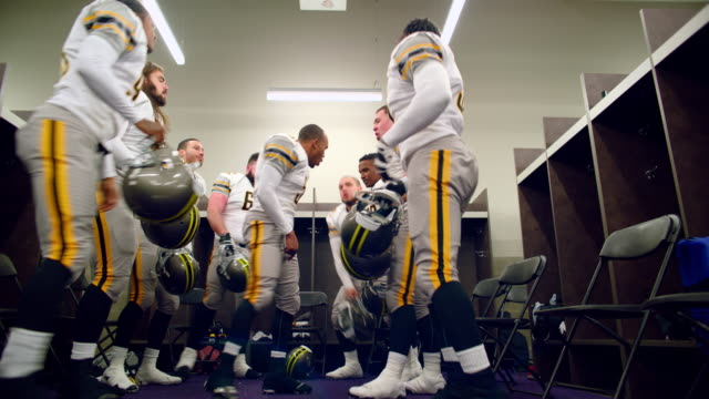 ms la professional football team getting motivated in locker room before game - locker room stock videos and b-roll footage