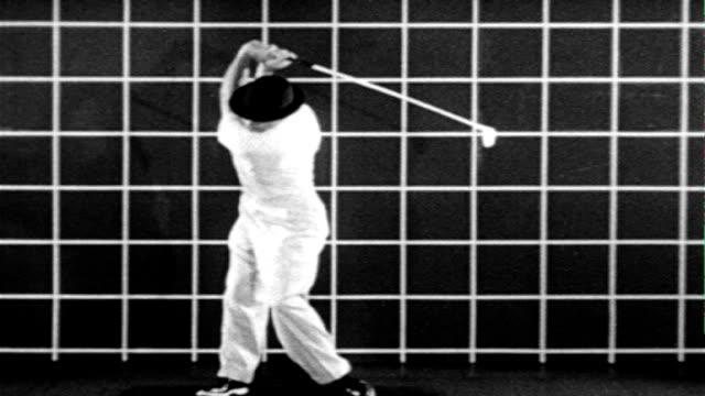 ws professional golfer sam snead on set w/ golf tee and grid wall bg demonstrating forward press slo mo ms illustrating press w/ superimposed lines... - film set stock videos & royalty-free footage