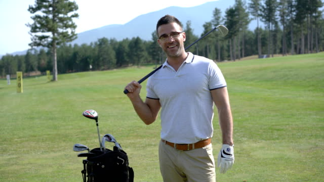 professional golfer taking a break after teeing off - golf bag stock videos & royalty-free footage