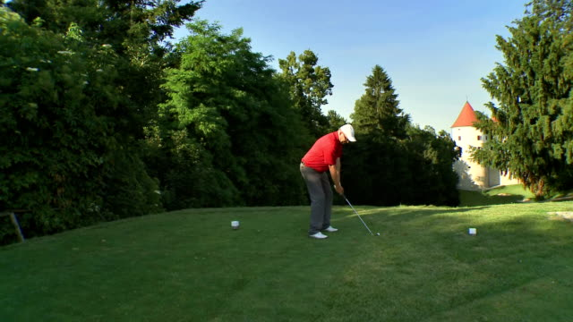 aerial professional golfer teeing off - teeing off stock videos & royalty-free footage