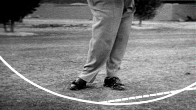 professional golfer usa ben hogan on course fairway w/ mountains distant usingwood club swinging standing looking up fairway / slo mo hogan on... - golf swing from behind stock videos & royalty-free footage