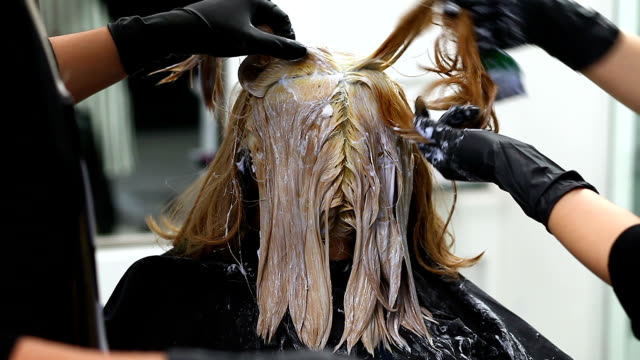 professional hairdresser coloring girl's hair - coloring stock videos and b-roll footage