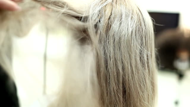 professional hairdresser drying girl's hair - human hair stock videos & royalty-free footage