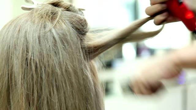 Professional Hairdresser Drying Girl's Hair