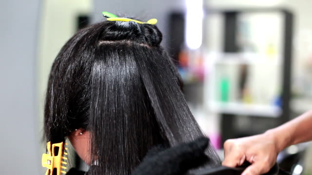 professional hairdresser straight hair - straight hair stock videos and b-roll footage