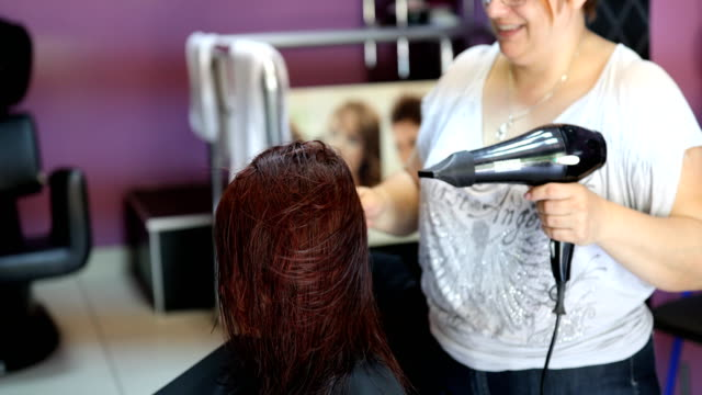 professional hairdresser using hairdryer - hairdresser stock videos & royalty-free footage