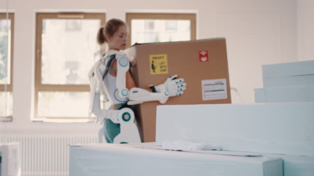 professional home mover woman in powered exoskeleton. - exoskeleton stock videos & royalty-free footage
