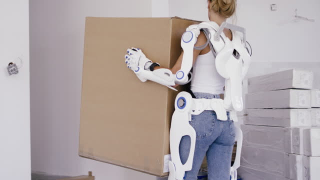 professional home mover woman in powered exoskeleton. - removal man stock videos & royalty-free footage