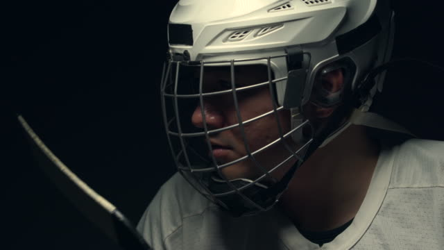 professional ice hockey player, one lighting in dark room. - hockey glove stock videos & royalty-free footage