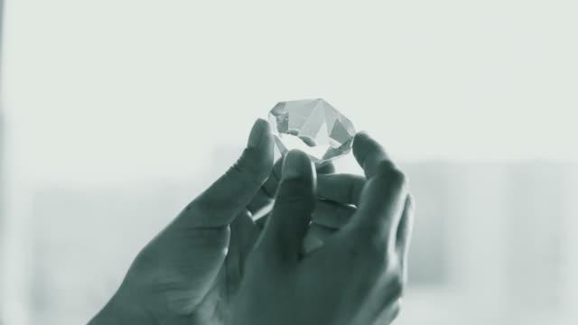 Professional jeweller inspecting a diamond